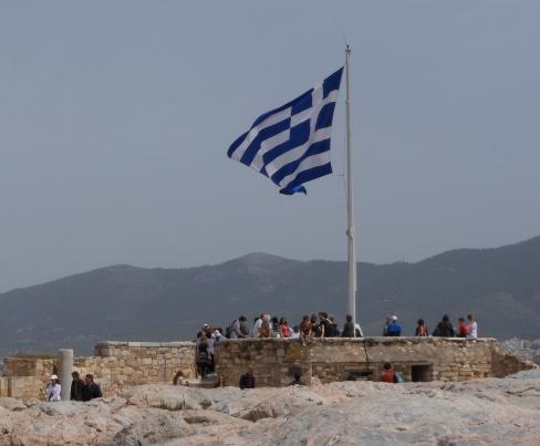 A Greek flag on top of the Acropolis in Athens. Photo: Olga Symeonoglou