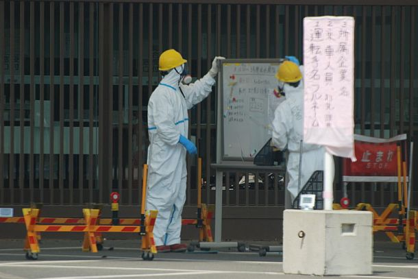 Guards at Fukushima nuclear plant 1 in April 2011. Photo: Wikimedia Commons Steve Herman