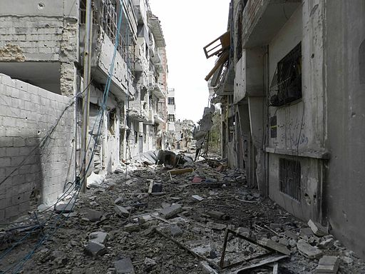 Destruction on a street in Syria. Photo Bo Yaser, wikimedia commons.