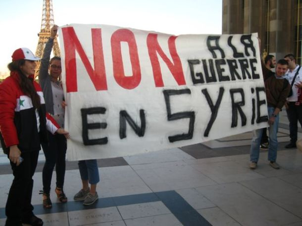"""Hollande is facing increased domestic pressure to avoid a military intervention in Syria. Translation: """"NO to the war in Syria."""" Photo: Morganmamaria for flickr."""