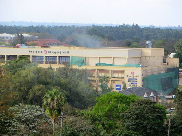 Smoke rises over the Westage mall in Nairobi as government forces storm the building. Photo: Anne Knight for Wikimedia Commons.