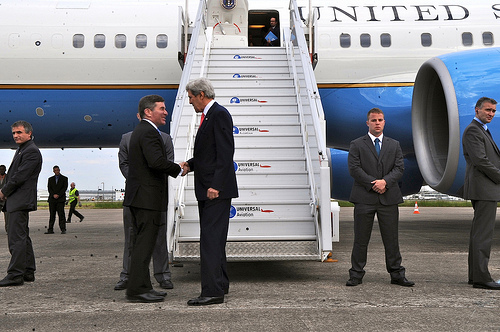 Secretary of State John Kerry flew to Paris in an effort to calm French concerns over US intelligence gathering.