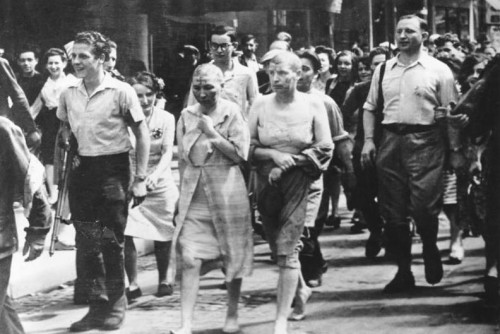 """""""Les Tondues"""" accused of collaborating with German forces are publicly shaved during Liberation.  Photo: German Federal Archive via Wikimedia Commons."""